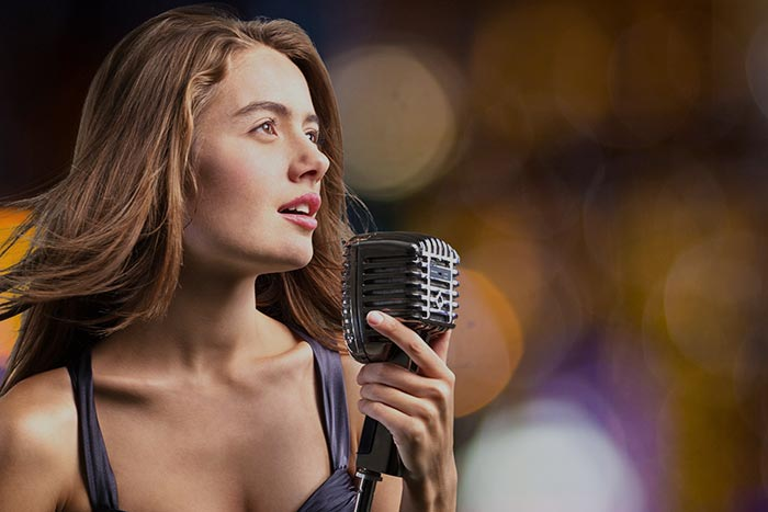 Lady singing in a microphone