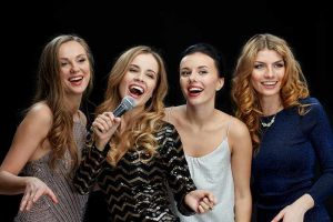 Ladies singing together in a group format