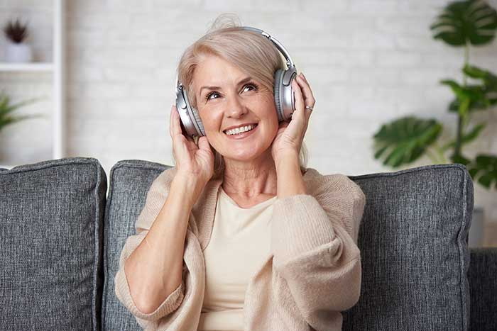 Senior lady enjoying music
