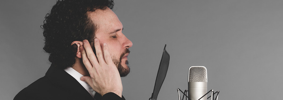 man listening to his voice