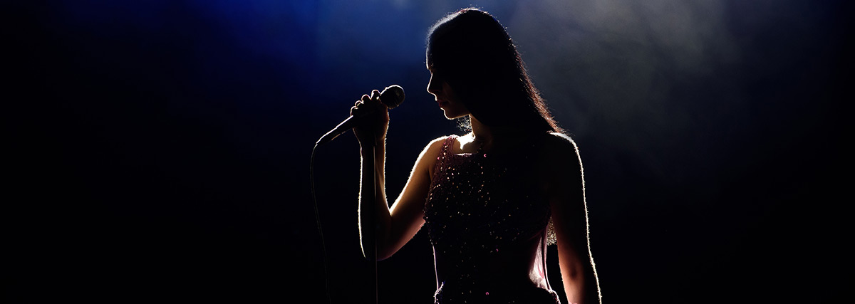 silhouette of a woman on stage