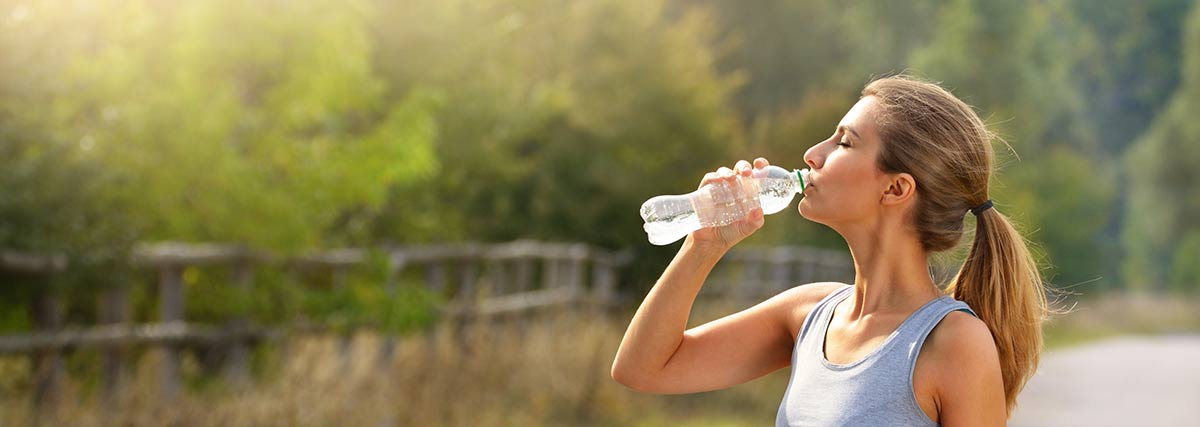 woman hydrating herself
