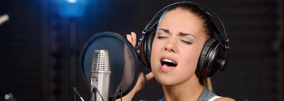 woman singing in a recording studio