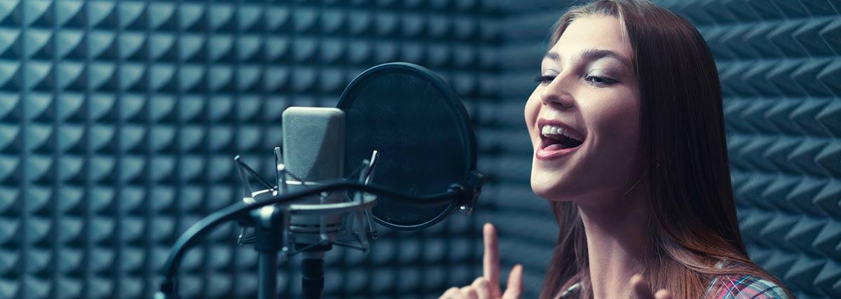 woman singing inside the  recording studio