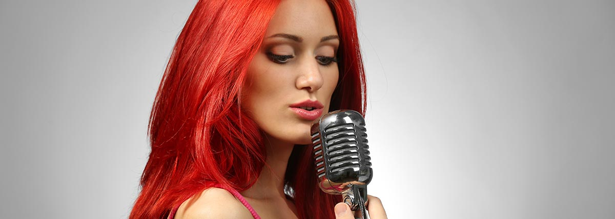 red-haired-woman-singing