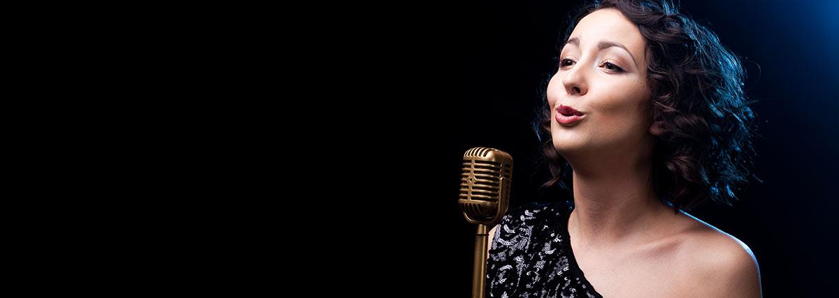 woman-in-black-singing