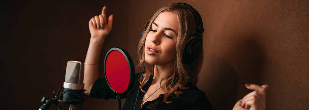 woman-recording-her-song