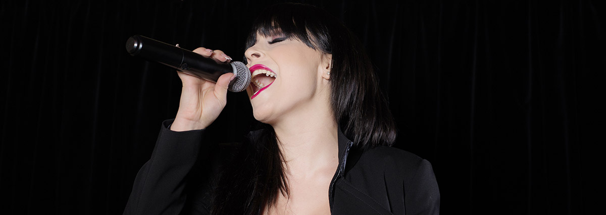 woman-with-bangs-singing