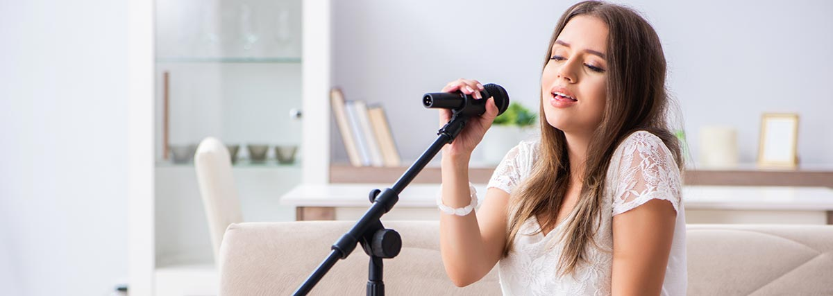 woman practicing singing at home