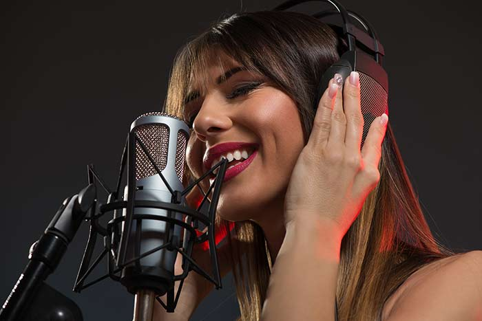 woman recording in a recording studio feat