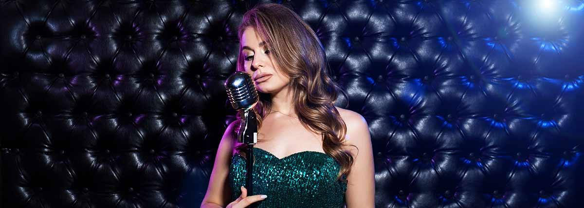 female singer with black background