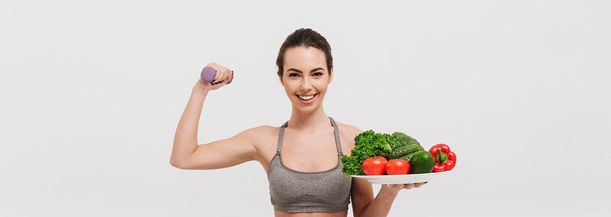 fit woman holding healthy food