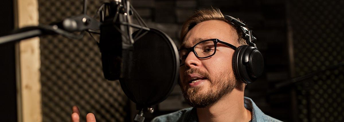 man singing in a recording studio