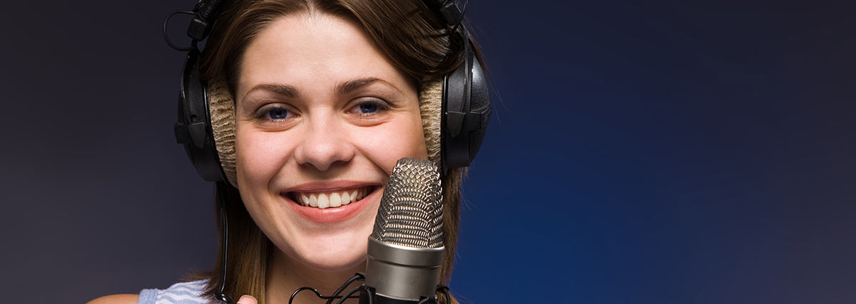 singer smiling in studio