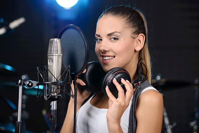 woman inside the recording studio feat