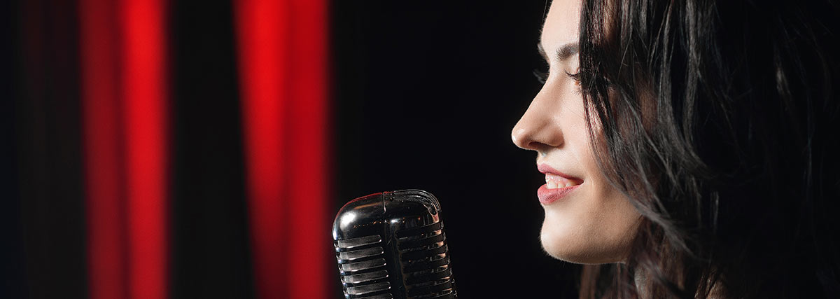 woman on stage singing