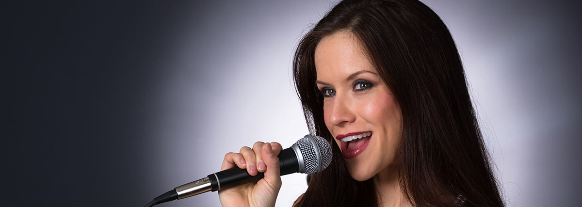 woman with microphone singing