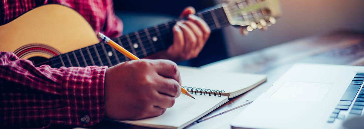 man writing a song