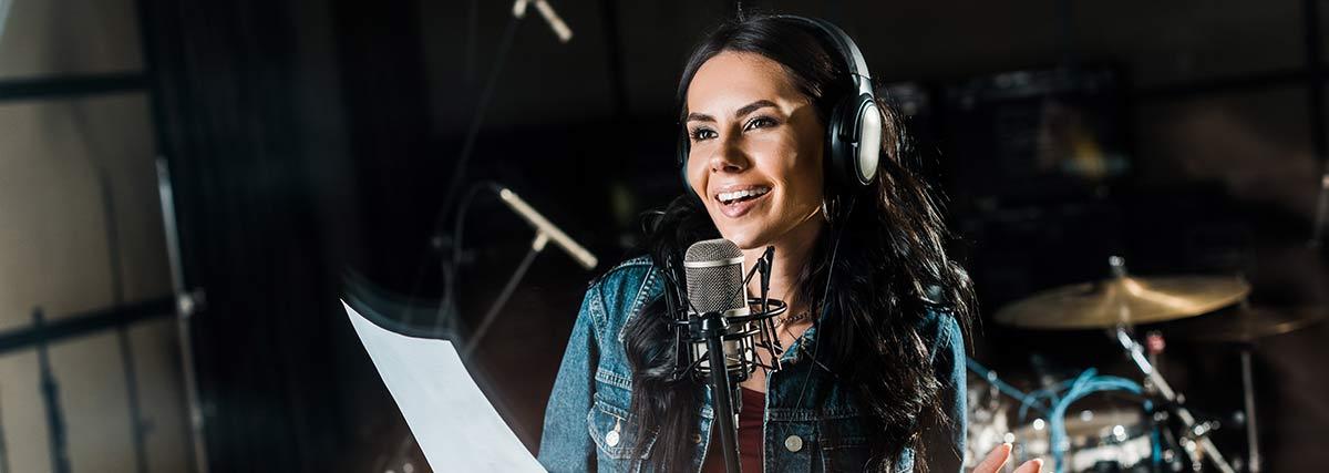 woman singing in the studio
