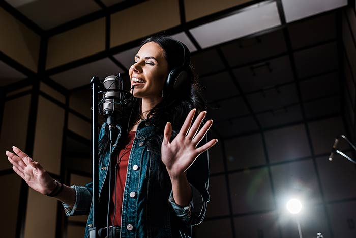 woman singing in the studio feat