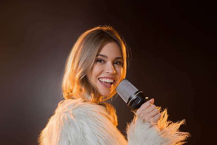 woman performing with microphone feat