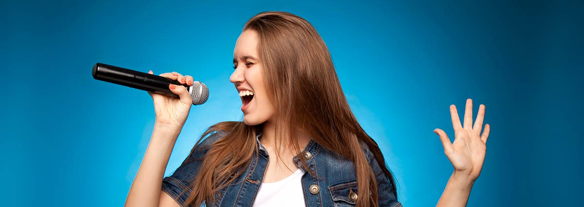 woman with blue background singing