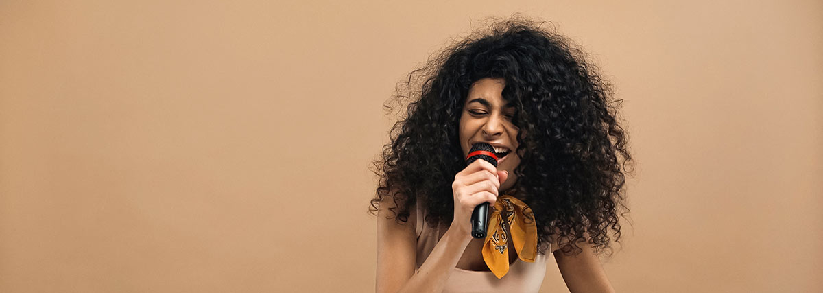 woman-with-scarf-singing